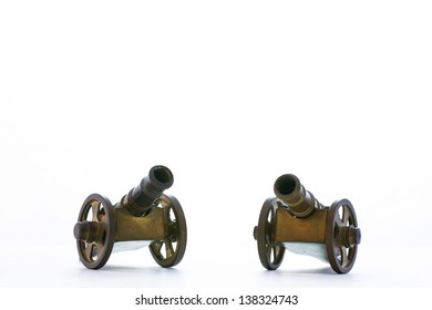 Brass cannon model on white background