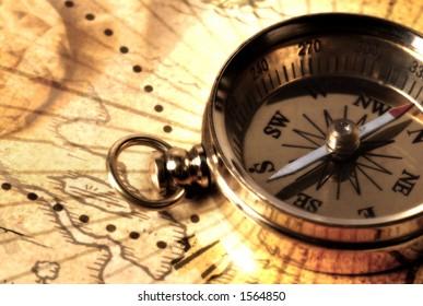 Brass Compass on a Map