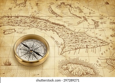 Brass compass rose on a particular of an historical Caribbean map