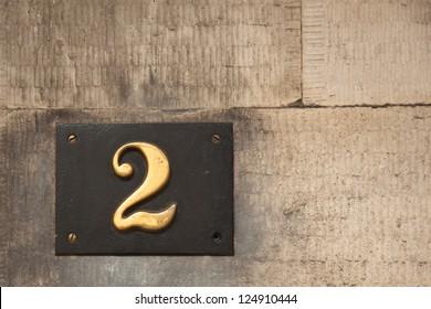 Brass Door Number 2 Mounted on Stone Facade Scotland