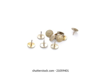 Brass drawing pins isolated on a white background