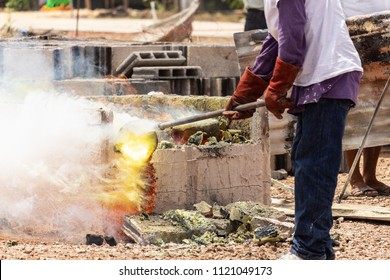 Brass furnace, flame, brass container. Workers firing in kilns to perform religious ceremonies. To create a Buddha image.