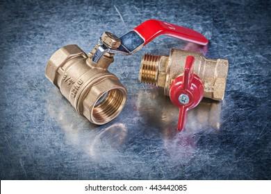 Brass gate water lever ball valve on metallic background plumbing concept.