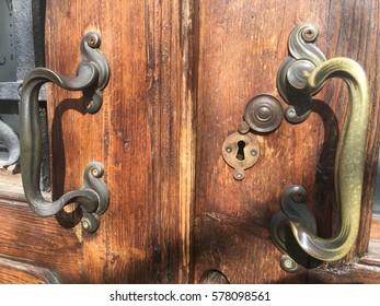 Brass handle of an old wooden door
