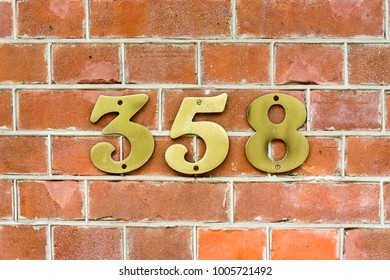 Brass house number three hundred and fifty eight (358)