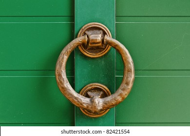 brass knocker on the green door