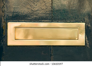 A Brass Mail Slot on a Green Door
