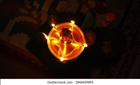 brass oil lamps setup for a traditional kerala  hindu wedding ceremony.