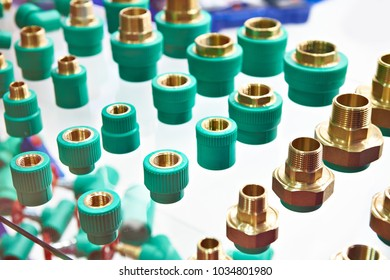 Brass plastic adapters for pipes of plumbing system