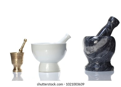 brass porcelain and marble mortars   on white background