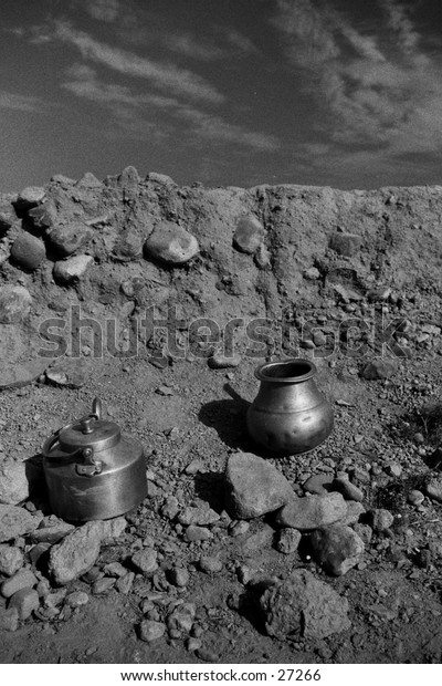 Brass pots in the dirt