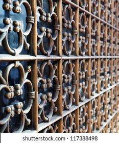 Brass security window ornamentation diminishing to soft focus