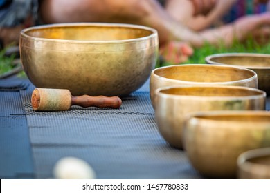 Brass set of singing bowls for yoga and meditation outdoors