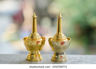 Brass sprinkling water in Thai style, with a Buddhist ceremony, white background.