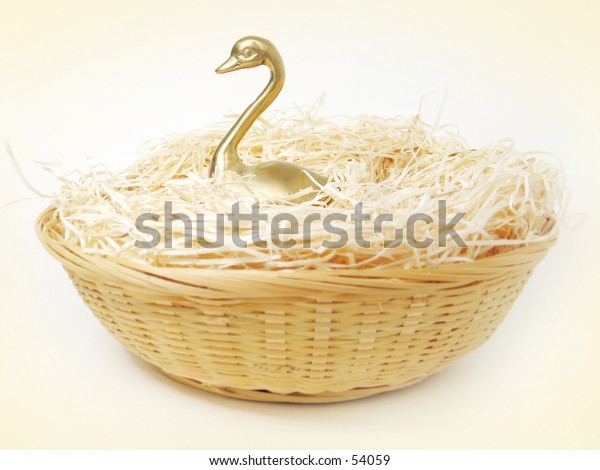 A brass swan in a basket.