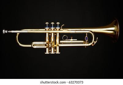 brass trumpet over black background