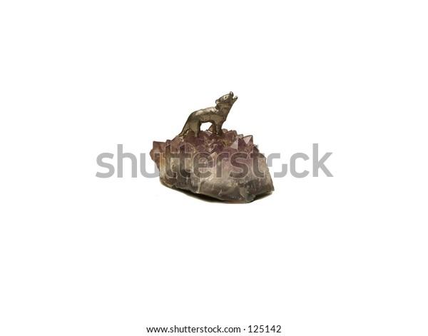 Brass wolf mounted on amethyst crystal