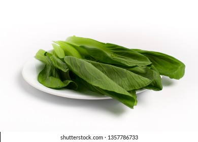 Brassica chinensis, Chinese Cabbage for hot pot on white ceramic dish isolated on white background