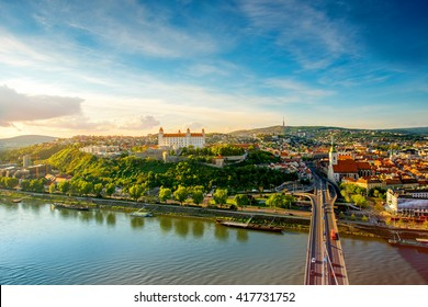 Bratislava aerial cityscape view on the old town with Saint Martin's cathedral, castle hill and Danube river on the sunset in Slovakia. Wide angle view with copy space