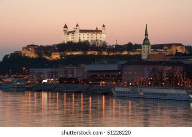 Bratislava castle above Danube river at dusk, Slovakia