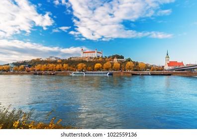 Bratislava castle, parliament and Danube river at beautiful fall day, Bratislava, Slovakia