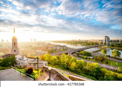 Bratislava cityscape view with modern bridge, Danube river and old town from the castle hill on the morning in Slovakia