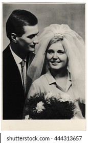 BRATISLAVA, THE CZECHOSLOVAK SOCIALIST REPUBLIC - DECEMBER 11, 1965: Retro photo shows bride wears a white veil and groom wears a dark suit.  Black & white vintage photography of wedding couple.