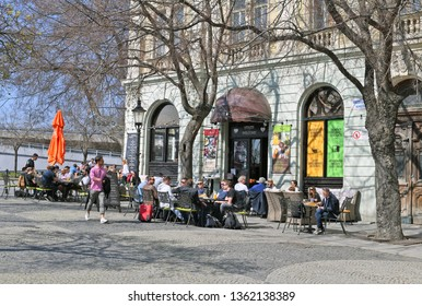 Bratislava, Slovak Republic - March 31, 2019: Tables restaurant in the old streets of the city.
