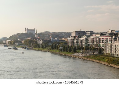Bratislava, Slovakia - 10/10/2014 - Panorama photo from Apollo bridge of business centre on riverside with New National Theatre,  and Bratislava Castle in distance.