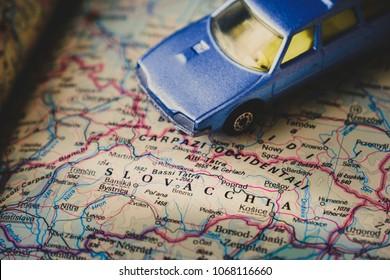 Bratislava, Slovakia, 12 Apr 2018 - A Slovakia map and a blue toy car