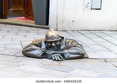 Bratislava, Slovakia - 15 March 19: Cumil, The Man at Work statue, aka, The Watcher. Famous sculpture in Bratislava, Slovenia, depicting a sewage worker peeping out of a manhole at passers-by.
