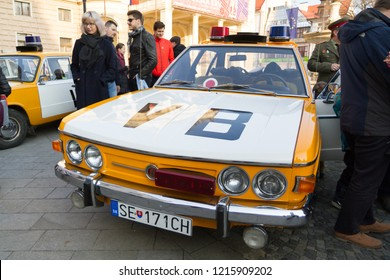 """Bratislava, Slovakia. 2018/3/24. A re-enactment of the Candle manifestation of 1988/3/25 with the notorious """"VB"""" (Verejna bezpecnost) communist police cars and policemen of the former Czechoslovakia."""