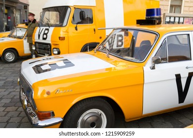 "Bratislava, Slovakia. 2018/3/24. A re-enactment of the Candle manifestation of 1988/3/25 with the notorious ""VB"" (Verejna bezpecnost) communist police cars and policemen of the former Czechoslovakia."