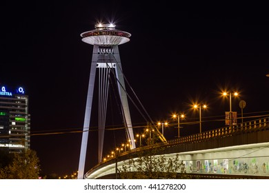 BRATISLAVA, SLOVAKIA - 29TH APRIL 2016: The UFO Tower and Novy Most Bridge at night. The UFO Tower offers high views of the city,
