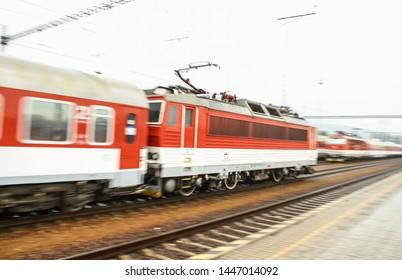 Bratislava, Slovakia - 6/16/2017: Passing train on the trainstation, photo took from trainstation platform.