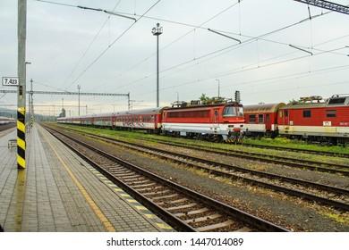 Bratislava, Slovakia - 6/16/2017: Trainstation with parked trains. Photo from the trainstation platform.