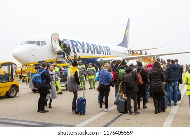 Bratislava, Slovakia. 8 January 2018. A Ryanair Boeing 737-800 aircraft parked at the Bratislava airport runway. People are boarding the plane.