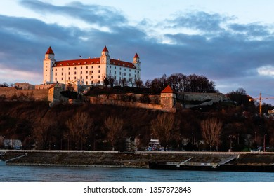 Bratislava, Slovakia: aerial view of Bratislava castle standing above the old town at sunset