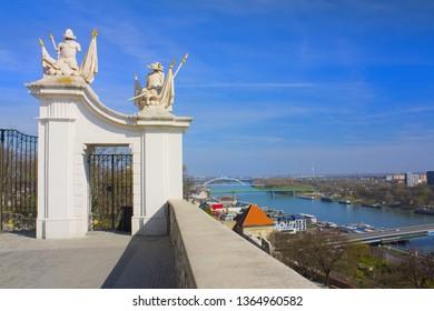 BRATISLAVA, SLOVAKIA - April 1, 2019: Rich decorated gate in Bratislava Castle and panorama of a river in Bratislava