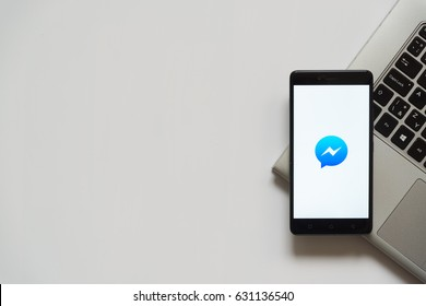 Bratislava, Slovakia, April 28, 2017: Facebook messenger logo on smartphone screen placed on laptop keyboard. Empty place to write information.