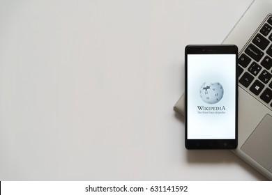 Bratislava, Slovakia, April 28, 2017: Wikipedia logo on smartphone screen placed on laptop keyboard. Empty place to write information.