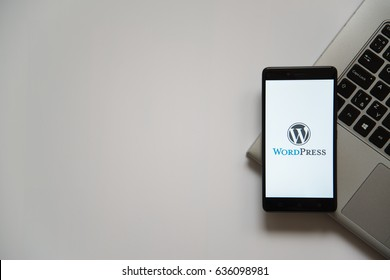 Bratislava, Slovakia, April 28, 2017: Wordpress logo on smartphone screen placed on laptop keyboard. Empty place to write information.