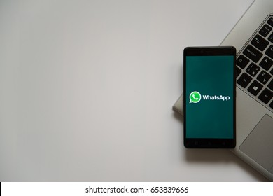 Bratislava, Slovakia, April 28, 2017: Whatsapp logo on smartphone screen placed on laptop keyboard. Empty place to write information.