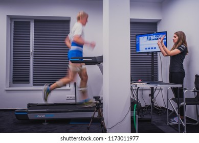 BRATISLAVA, SLOVAKIA, AUGUST, 23, 2018: Athlete running in medical center. Biomechanics analysis of running