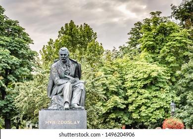 BRATISLAVA, SLOVAKIA - AUGUST 26, 2019:  sunlight is enlightening Statue of Hviezdoslav in Bratislava, capital of Slovakia