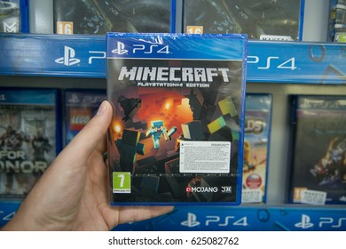 Bratislava, Slovakia, circa april 2017: Man holding Minecraft videogame on Sony Playstation 4 console in store
