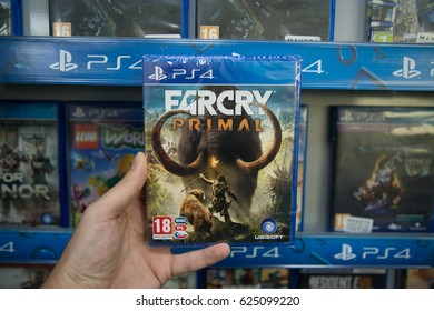 Bratislava, Slovakia, circa april 2017: Man holding Farcry primal videogame on Sony Playstation 4 console in store