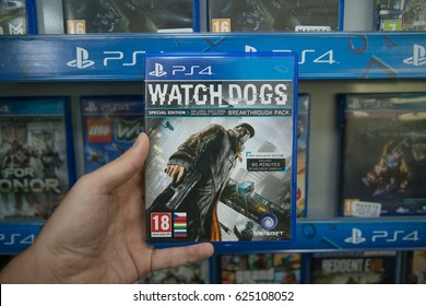 Bratislava, Slovakia, circa april 2017: Man holding Watch Dogs videogame on Sony Playstation 4 console in store