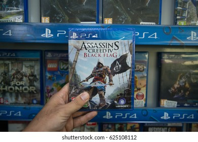 Bratislava, Slovakia, circa april 2017: Man holding Assassin's creed Black Flag videogame on Sony Playstation 4 console in store