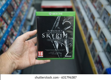 Bratislava, Slovakia, circa april 2017: Man holding The Elder Scrolls V: Skyrim Special Edition videogame on Microsoft XBOX One console in store